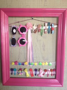 little girl hair clip storage frame, spray paint in berry pink from home depot. frame from good will - $2    saw it on pinterest, nailed it. lol