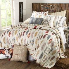 Be Bold, Be Brave Quilted Bedding Collection- A stunning feather and arrow pattern is highlighted by a neutral color pallet of grey, linen, dusty blue, maroon and ochre on a luxe cream background.