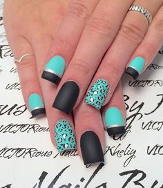 Blue and black leopard nail art design. The matte effect of the design is absolutely stunning. The French tip is then bordered by silver metallic to emphasize the division.