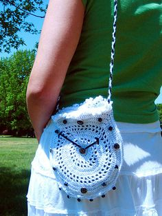 """Tea Time Crochet Purse. This free crochet pattern from @elena K is a purse inspired by Alice in Wonderland. """"'And ever since that,' the Hatter went on in a mournful tone, '[Time] won't do a thing I ask! It's always six o'clock now.' A bright idea came into Alice's head. 'Is that the reason so many tea-things are put out here?' she asked. 'Yes, that's it.' said the Hatter with a sigh: 'it's always tea-time, and we've no time to wash the things between whiles.'"""""""
