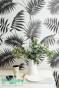 DESCRIPTION Transform any room in your home into a tropical paradise with this self adhesive wallpaper! This vinyl wallpaper features a print of grey palm areca leaves wall decals. Grey palm areca lea