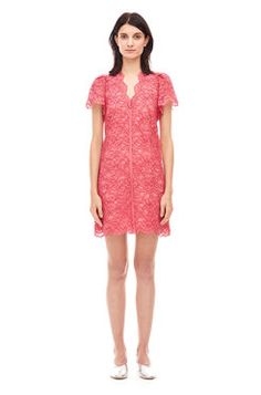 V Neck Lace Dress -  Rendered in bold coral lace, this playful dress packs a punch with puffed sleeves and scalloped hems. Pair it with metallic slides for an elevated après-beach look. Zip back.