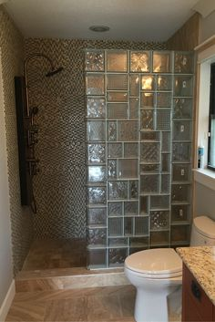 Don't be afraid to inject personality into a shower wall design. This glass block wall (which is still in the process of being finished) used multiple glass block patterns to create a mosaic beveled glass type of look. Click through for more ideas.