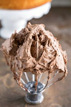 This chocolate buttercream frosting is silky, chocolate perfection! Not too sweet - perfect for frosting any cake or cupcake!