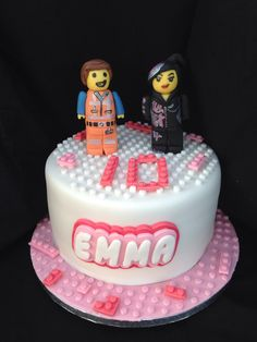 Lego movie theme cake. Emmet and wyldstyle Mandy made fondant toppers