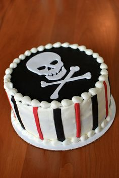 Skull and crossbones birthday cake. Buttercream with fondant accents