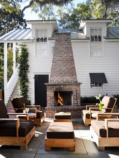 Designer Jane Frederick made a traditional brick fireplace the focal point of this outdoor space.#Repin By:Pinterest++ for iPad#