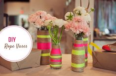 DIY rope vases. fun to include wedding colors or give your neutral palette a pop.