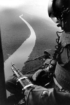 The Vietnam War, door gunner from the 9th Division flying over the Mekong Delta, South Vietnam, December 1967.