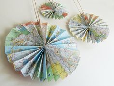 Create rosettes out of maps (instructions here) for decor at a travel-themed party or wedding. Source: Etsy User GrannyPantyDesigns