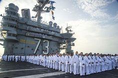 Aug. 23, 2013 - Sailors aboard the U.S. Navy's forward-deployed aircraft carrier USS George Washington (CVN 73) fall into formation to man the rails as the ship returns to Commander, Fleet Activities Yokosuka, Japan.