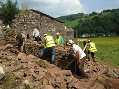More amazing Heritage at Work volunteers rebuilding a dry stone wall under the expert eye of John Barber and Luke.