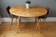 SOLD  Mid century Ercol round drop leaf by OwlAndTheElephant