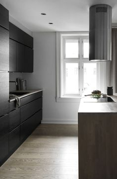 Streamlined kitchen in Oslo with dark wood cabinets and oak island and floor. Home, Contemporary Interior Design, Sale House, Kitchen Inspiration Design, House Styles, Interior Design, Contemporary Interior Design Living Room, Home And Living, Apartment Style
