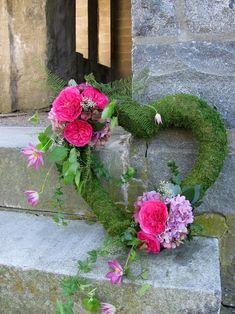 Cathy Walsh's profile photo  Cathy Walsh  24. Mossy sympathy heart with roses and hydrangeas.