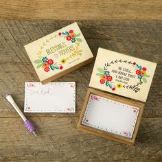 "Wooden Prayer Box ""Blessings & Prayers"" - This cream with gold wreath painted wooden prayer box says ""Blessings & prayers"" and comes with paper notes, mechanical pencil, and an inspirational message inside the lid. Enough notes for 50 prayers!"