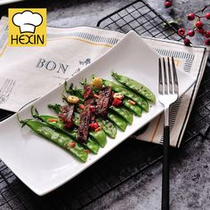 white serving platter is rectangle plate. High quality & durable serving platters in different styles and sizes are perfect for restaurants and clubs. Appetizer Plates, Appetizers, Rectangle Plates, Kitchen Ware, Serving Platters, Green Beans, Dinnerware, Catering, Commercial
