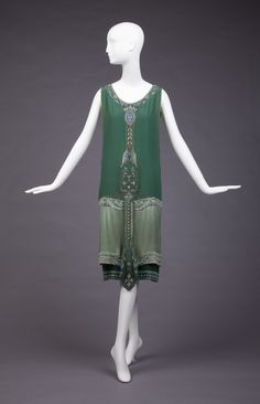 (a) overdress of green satin with beading at neck, center front, hipline, hem (b) slip dress, off-white with green border of beading around bottom. Soeurs Callot, 1925. Goldstein Museum of Design