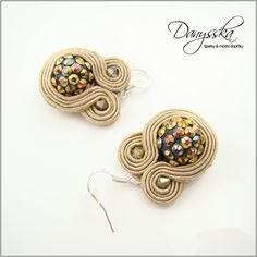 The earrings are made of soutache cord, glass beads and shamballa beads.    They are backed with Ultrasuede.    They are 2.7 cm (1.06 inches) long - measured without fishhook.      Specification:    - color: beige, gold  - length: 2.7 cm (1.06 inches) - measured without fishhook  - materil: soutache cord, glass beads, shamballa beads, Ultrasuede  - material of components: silver plated metal | Shop this product here: spreesy.com/danysska/399 | Shop all of our products at…