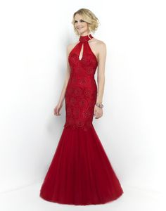 This red carpet worthy mermaid features a high neck, sexy low back, and an intricately beaded bodice. Voluminous skirt has a finished hem and sweeping train. Available in Carmine and Mint Blush Prom
