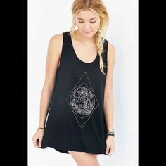 NWT Urban Outfitters Open Back Top black, open back top with a slight hi/low. new with tags. size medium. Urban Outfitters Tops Tank Tops