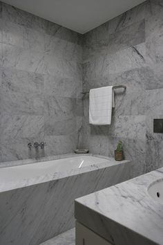 Denai Kulcsar Interiors - bathrooms - marble tiled walls, large scale marble tile, carrera marble, carrera marble wall tile, carrera marble ...