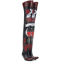 Vetements - Painted leather over-the-knee boots - VETEMENTS' over-the-knee boots are an irresistible statement style. Crafted from smooth black leather, the Western-inspired silhouette comes up higher than mid-thigh and is hand-painted for an ornate, authentic look. Topped off with the label's instantly recognisable take on the Cuban heel, these promise to be a conversation starter. seen @ www.mytheresa.com