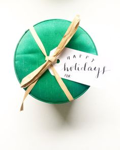 Happy Holidays gift tag by M.B. Calligraphy can be found on www.mbcalligraphy.com