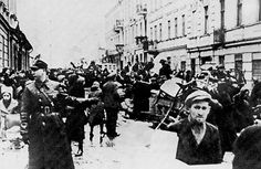 Jews of Lodz, forcibly driven from their homes  to the newly established Lodz (Litzmanns Stadt) Ghetto in the Baluty quarter of the city, February 1940
