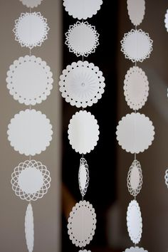 Set of 5 white lacey circles dangling paper garland wedding decoration baby shower birthday party christmas. $11.00, via Etsy.