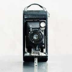I just bought a vintage camera that looks similar to this at my new favorite vintage store. Im determined to figure out how it works and use it.