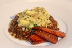 Flavoursome mince lamb cooked with a herb rich gravy, topped with crushed potato and served with delicious pan fried carrots.