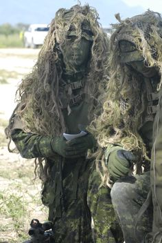 Canadian Special Operations Regiment snipers plan an entry strategy into the Sniper stalk event field. June 9, 2012.