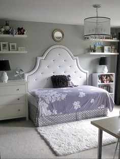 Love the arrangement of this room with the bed in the middle.