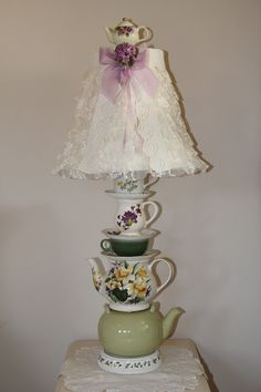 Teapots and teacups lamp with ruffled lace shade.