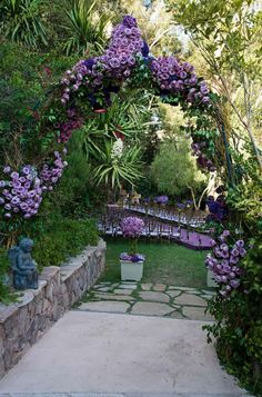 Purple roses arranged on a verdant garden archway highlight a path to a secret-garden wedding ceremony. Description from pinterest.com. I searched for this on bing.com/images