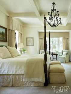 Vintage French Soul ~ In the master bedroom and bath, custom draperies in a luxe Cowtan & Tout fabric frame garden views.