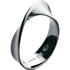 Designed by Vivianna Torun Bülow-Hübe, the Mobius ring by the Georg Jensen company of Denmark was launched in 1968. A beautiful timeless classic!