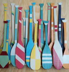 Oar, fishing boat, nautical decor, wall art, wall hanging, rowboat  Decorative boat oars measuring 40 tall in varying shapes and 6-7 widths. Shown finished in navy, white and gray and also daffodil, white and aqua sea wind. You can also copy and paste the Glidden color chart below for many more color options. The last photo shows a large custom order that had many different designs if youd like something different. Since your order is hand cut when received, I can customize to your size…