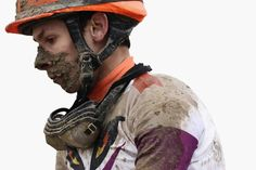A jockey looks on after racing in a