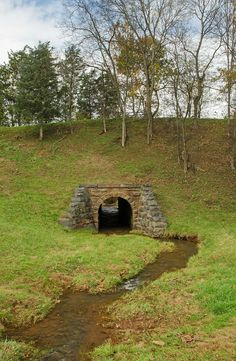 """Fat Nancy Creek Tunnel 16x20 Metal Limited Edition w/Easel. This little creek tunnel is located near the historic site where the """"Fat Nancy"""" train wreck occurred outside of Orange, VA. The """"Fat Nancy Creek Tunnel"""" is printed on a recycled aluminum with a solid coating for a high gloss, high contrast finish. The product comes with an easel for easy displaying of this limited edition beautiful piece. Each piece will have a separately shipped Certificate of Authenticity for this Limited…"""