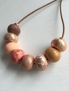 Rose gold necklace.