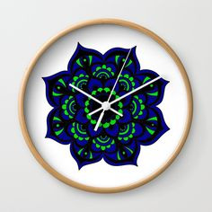 """Available in natural wood, black or white frames, our 10"""" diameter unique Wall Clocks feature a high-impact plexiglass crystal face and a backside hook for easy hanging. Choose black or white hands to match your wall clock frame and art design choice. Clock sits 1.75"""" deep and requires 1 AA battery (not included). Wall Clock Frame, White Frames, Unique Wall Clocks, Flower Mandala, Natural Wood, Peacock, Hands, Deep, Crystals"""