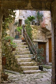 Looking in on an intimate courtyard along the street leading up to St. Euphemia church. Rovinj, Croatia by Ronald J. Anderson