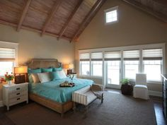 Spare furnishings and neutral colors keep the feel of this cottage-style bedroom restful and airy. Vibrant turquoise bedding adds a saturated focal point that's still easy on the eyes.