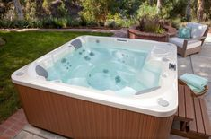 Hot Spring spas feature legendary quality and performance. Explore each spa's unique combination of style, features and price and you'll find the hot tub that is just right for you. Hot Tub Backyard, Backyard Retreat, Traditional Hot Tubs, Swimming Pool Chlorine, Hot Tub Cover, Water And Sanitation, Spring Spa, Waterfall Features, Spa Water