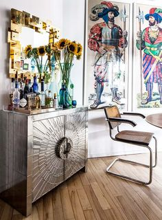 The Brooklyn loft of Jonathan Adler's Director of Interiors, Benjamin Brougham, featured on Design Sponge. The Jonathan Adler Talitha Console Cabinet gives the room a lustrous glow, especially paired with the brass midcentury mirror (JA Puzzle Mirror).