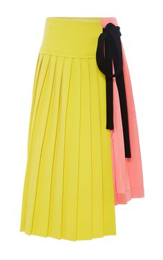 Rendered in bonded crepe with a colorblock design, this Marni skirt features a wraparound silhouette with a self-tie bow at the front, a fitted yoke with knife pleats around the hips, and a midi length asymmetric hem. Preorder now on Moda Operandi