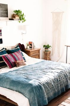 Bohemian Charm Meets Mid-Century Modern bedroom. Love the indigo blanket on white bedding!