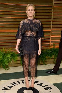 Pin for Later: Diane Kruger's Red Carpet Style Is So Stunning, We Can Hardly Believe She's Real  A sweet-cum-sexy lace Valentino cape dress for Vanity Fair's Oscars party in 2014.